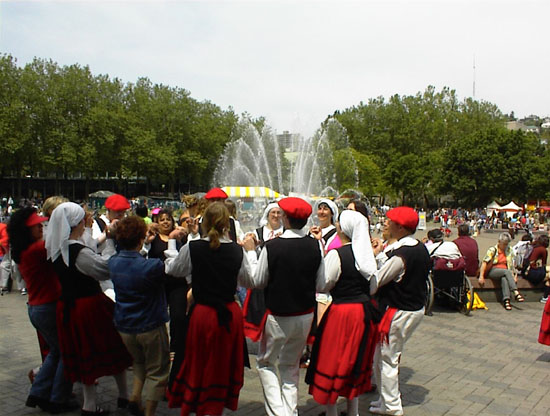 Storm Mountain Folk Dancers header with picture of dancers in Basque costume